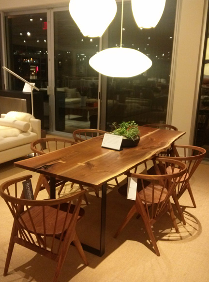 Check out the steel base on this table, and the gorgeous spindles that extend down below the seats on the chairs.