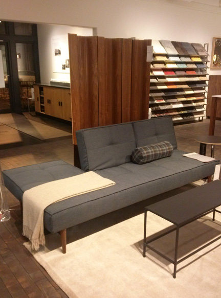 Small-apartment dwellers, take notice! The back of this sofa folds down to become a double bed.