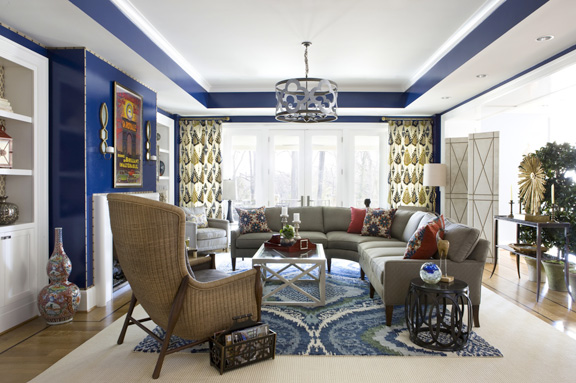 Curved sectional by Century; Woven-back wing chair by McGuire through Baker; Drapery fabric by Lee Jofa; area rug by Stark; chandy by Julie Neill through J. Lambeth & Co.; coffee table through AmericanEye
