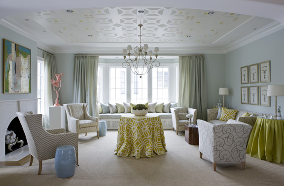 "The ""Camille"" wing chairs on the left are from Camille's new custom furniture line. Chandelier by Niermann Weeks."