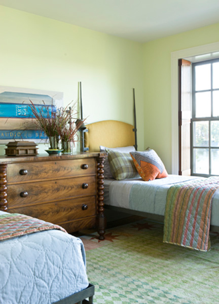 Designer Joe Ireland commissioned these iron beds and upholstered the headboard -- it gives a really great edge to the quilt/country look!