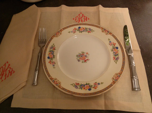 The square placemats take the place of a charger. It's shown here with Sally's grandmother's china.