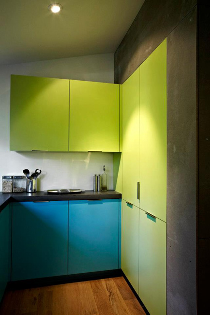 """Janet got a chance to try what none of her clients would: Pop-art colors on the cabinetry—a welcome change, she says, from the typical """"wood kitchen."""""""