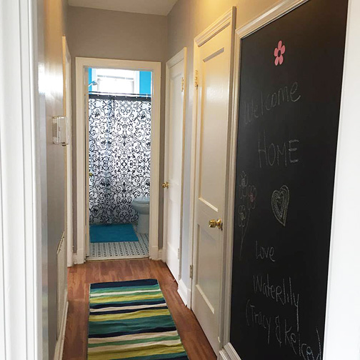 The bathroom also adds character when viewed down the hall. Its new carpet runner doesn't hurt, either.