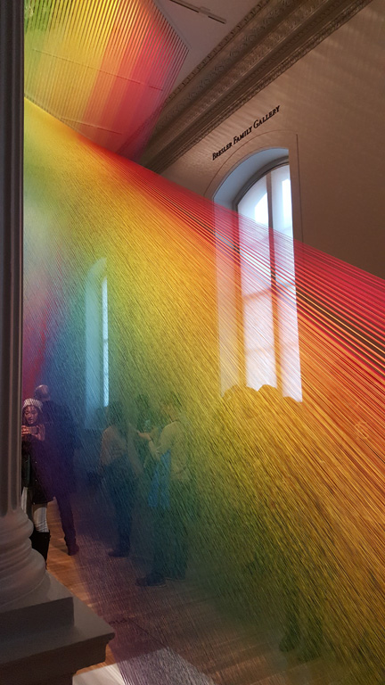 Smartphones out in abundance. But how could you not with an exhibit of woven thread that looks like light itself?