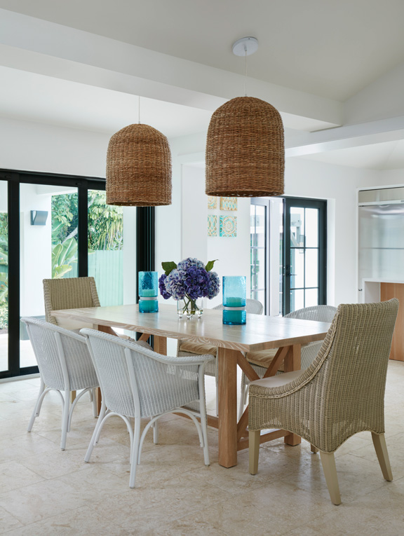 The pendants over the dining table are by Crate & Barrel. Table and side chairs by David Edward. Head chairs by Made Goods.