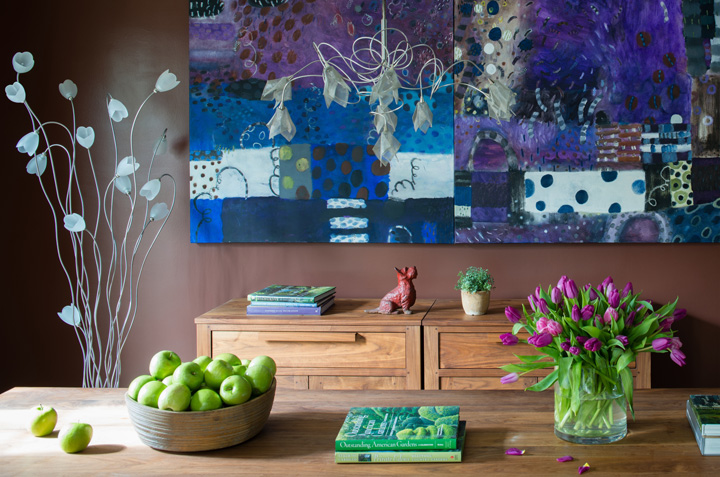 A painting by Capitol Hill resident Tati Kaupp highlights the dining room.