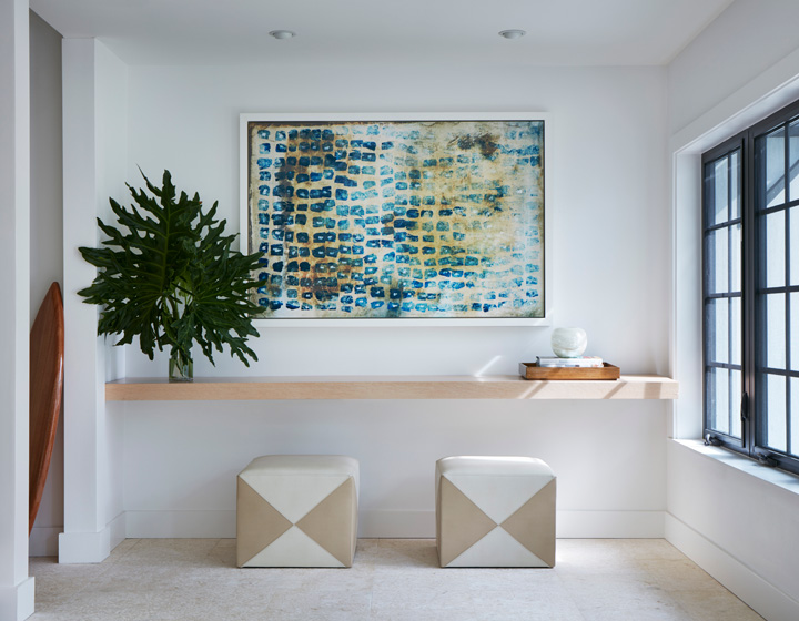The foyer is anchored with a giclee from Leftbank Art in California.
