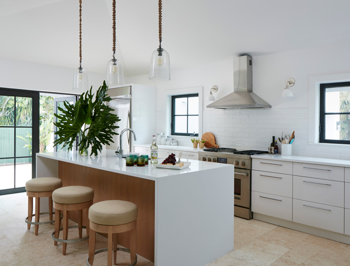 The kitchen. Sconces by Schoolhouse Electric; pendants by Crate & Barrel. Barstools by David Edward.