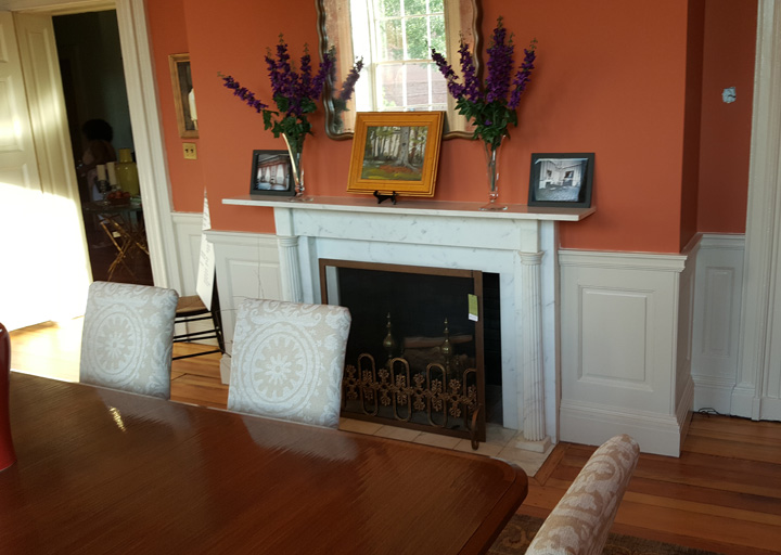 The Nantucket dining table is by Indiana-based Keith Fritz, the dining-chair upholstery is by Premier Prints in Mississippi, and the the fire screen is by Salvations.