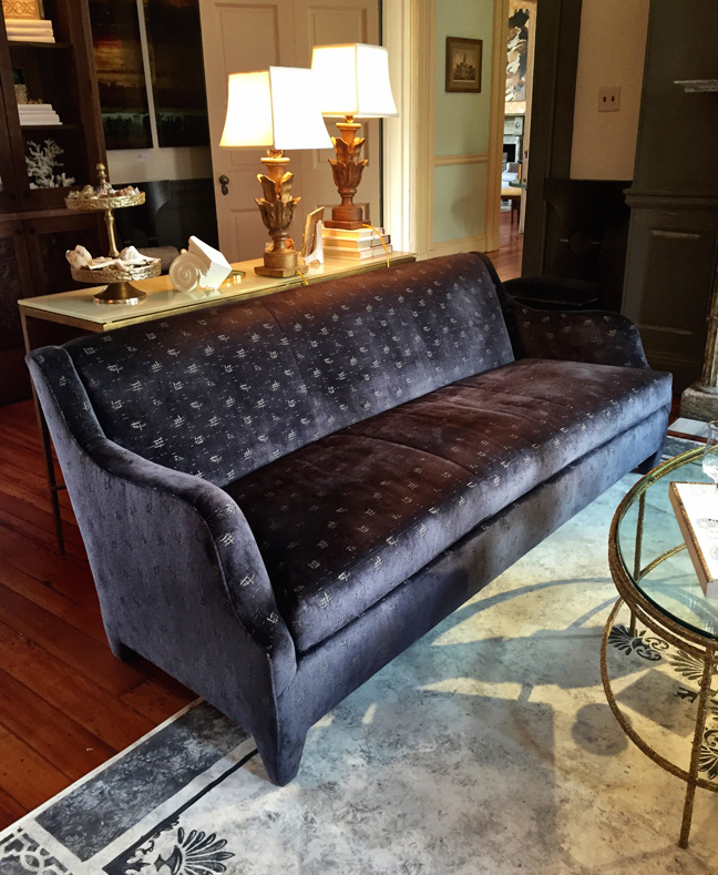 Beachley Furniture of Hagerstown, Maryland, produced Donghia's sofa design for the living room. The coffee table and sofa table are by Salvations. The Tivoli lamps are by Niermann Weeks. The hand-painted floor cloth is by Kate G Designs of Owings Mills, Maryland.