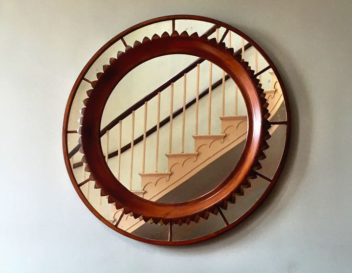 The artisans as Baltimore-based McLain-Wiesand crafted this Petal Mirror that beautifully reflects the detailing of the staircase.