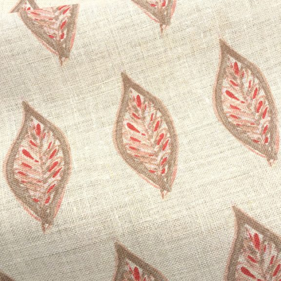 Her latest design, Leaves in Terra Cotta, is on a linen ground.