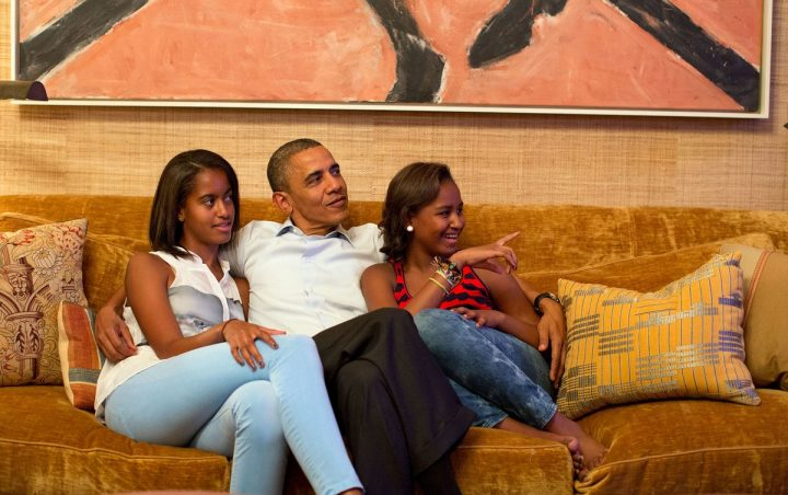 Malia and Sasha hang with their dad in the Treaty Room.
