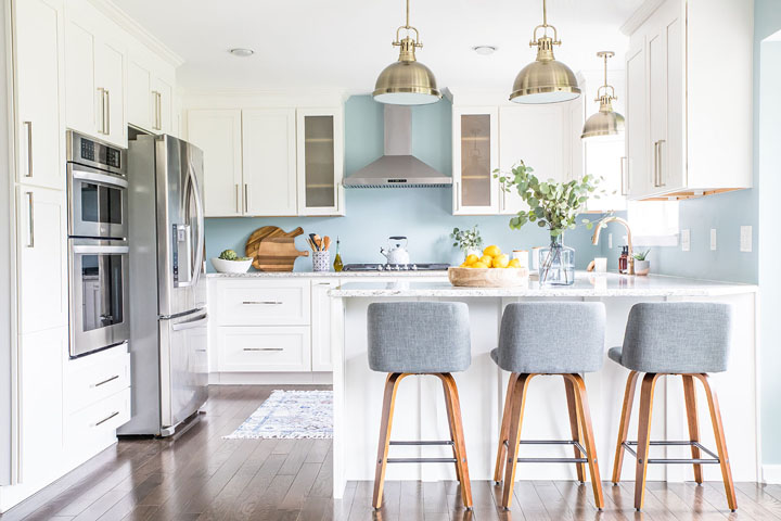 Pale blue and white kitchen with peninsula by Asha Maxey, Asha Maia Design