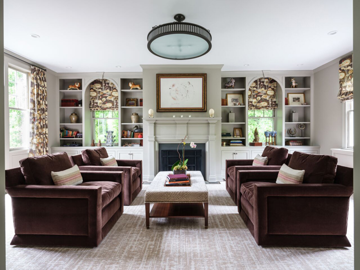 Family room in Alexandria, Virginia, with custom shelving and built-ins by  Iantha Carley Interiors.