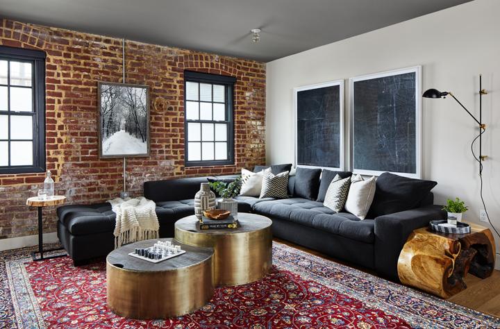 Modern condo living area with exposed brick by Morgan Taylor, Brass Bones Design
