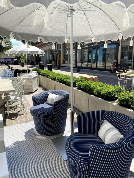 Outdoor seating, rugs, dining table and umbrellas at Serena & Lily in Bethesda, Maryland.
