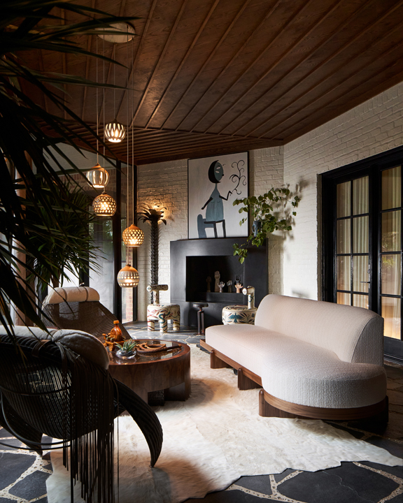 Screened porch with painted brick walls and fireplace by Tracy Hardenburg at the 2020 Kips Bay Dallas showhouse