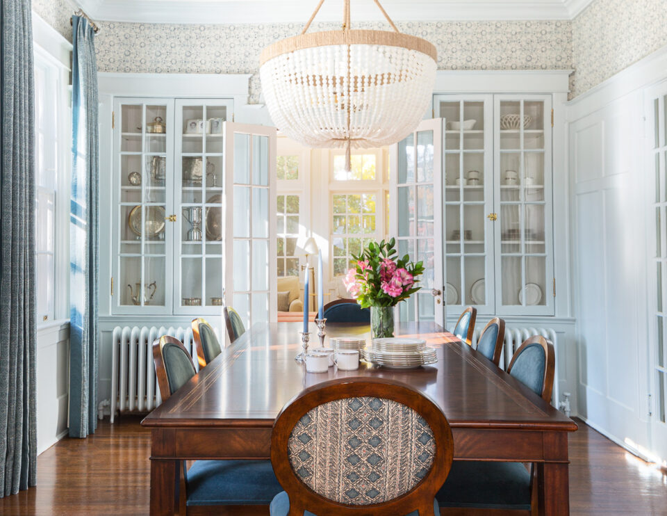 Living room with wallpaper, built-in china cabinet and Ro Sham Beaux chandelier
