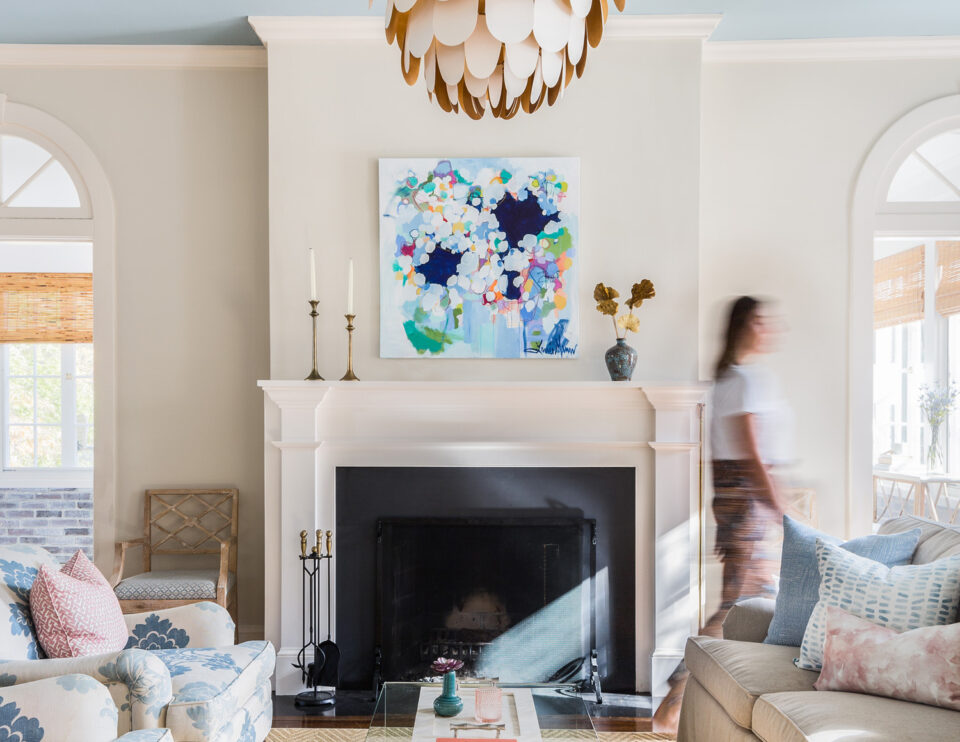 Living Room fireplace with artwork by Lanie Mann