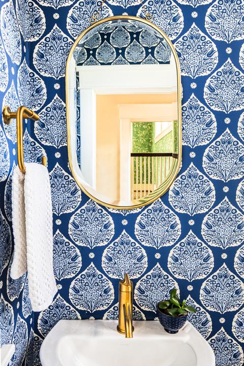 Powder room with Galbraith & Paul wallpaper, brass hardware