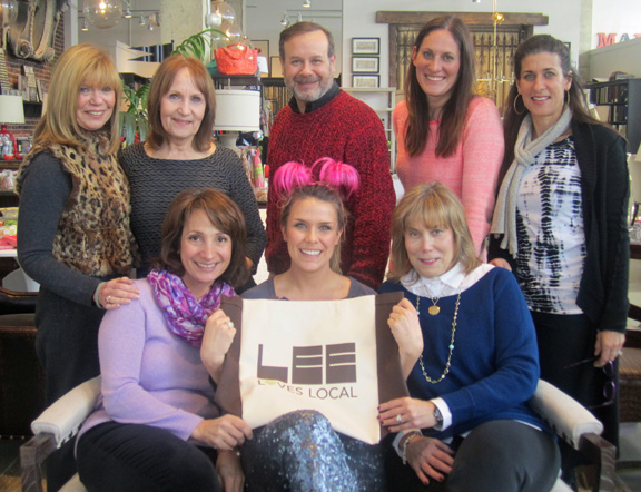 Urban Country's principals celebrate Tuesday's Lee Loves Local Open House. Seated, left to right: Amy Dunn, Hallie Walker, Amy Gudelsky. Standing, left to right: Owner Rachelle Roth, Terri Johnson, Jeff Kaye, co-owner Sasha Roth, Julie O'Brien
