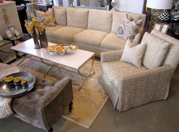 Lee's furnishings, such as this chenille sofa, leopard-print swivel chair and tufted velvet ottoman, fit well in most spaces, from traditional to contemporary.