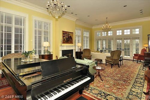 There's something way too cheerful about the yellow paint, especially with the enormous piano, fusty chandeliers, and huge Oriental rug. And what's up with the sofas? Why aren't they facing each other?