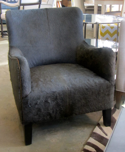 The hair-on-hide Serengeti Chair, $2,274 before the 10 percent discount.