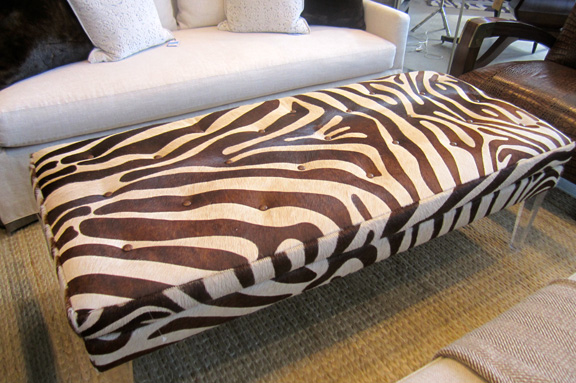 The Zora ottoman (LOVE those acrylic legs!) sells for $3,290 before this week's discount.