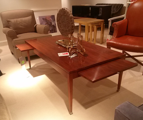 VERY cool coffee table with slideouts for drinks or a meal maybe?