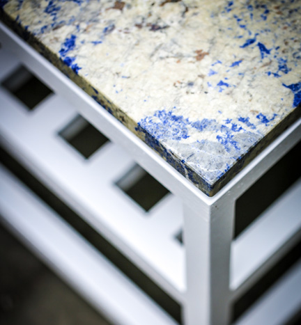 A detail shot of the table next to the blue seat above.