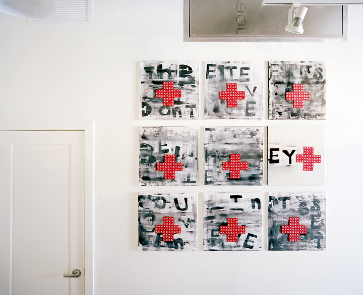 "Angela created this work using Scrabble tiles. ""State of Emergency"" illustrates a political message, such as protests against the Iraq war, that's been slowly scrubbed away through time."