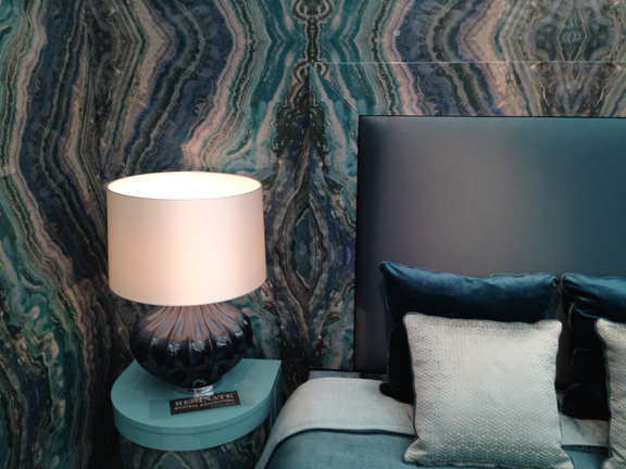 """Here, the wallpaper was """"resinated"""" on to the hard surface of the headboard."""